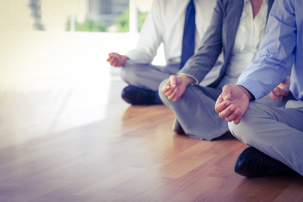 Employee Wellbeing Management - Business people doing yoga in office